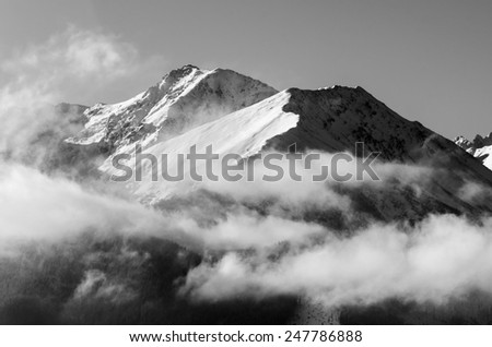 Morning mountains in the clouds - stock photo