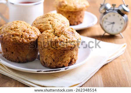 Morning muffins full of carrot, fruit and nut - stock photo