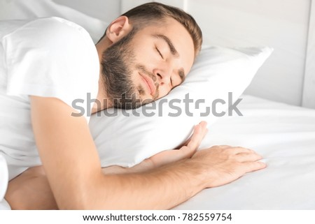 Morning of handsome man sleeping in bed at home