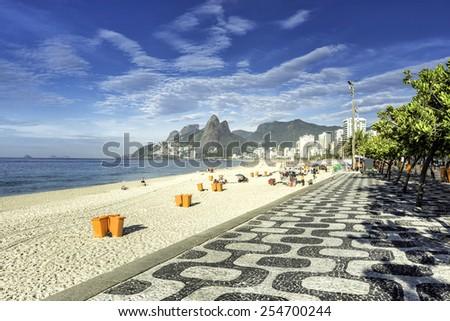 Morning on Ipanema Beach with mosaic walkway in Rio de Janeiro,Brazil - stock photo