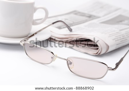 Morning paper with a cup of strong coffee