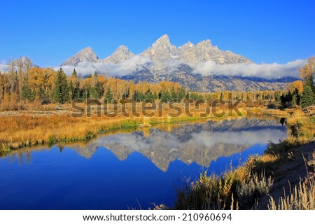 Morning reflection in the Teton's, Wyoming, USA.