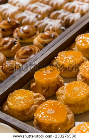 Morning shot of hotel breakfast pastry tray on self service buffet - stock photo