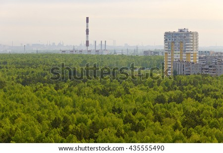 Morning silhouettes of city buildings on the edge of the forest.Russia.