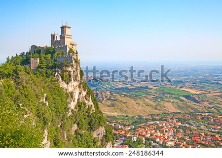 Morning sky over ancient fortifications of the San Marino - stock photo