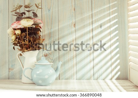 Morning still life on shabby chic table and light from the blinds - stock photo