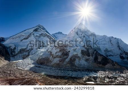 Morning sun above Mount Everest, lhotse and Nuptse from Pumo Ri base camp - Way to Everest base camp - Nepal  - stock photo