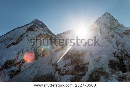 Morning sun above Mount Everest, lhotse and Nuptse from Pumo Ri base camp - Way to Everest base camp - Sagarmatha national park - Nepal - stock photo