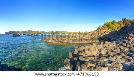 Morning sun on Giant Causeway when sun star shining down on bay radiating stone is recognized as a national landmark, this place attracts tourists to relax and explore