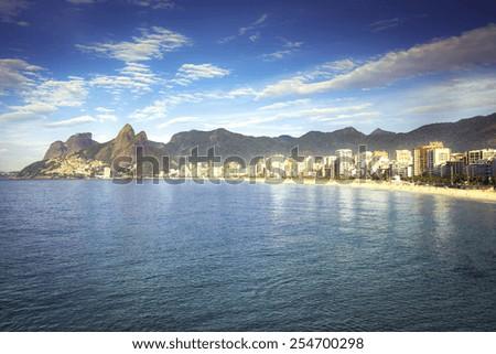 Morning sun on Ipanema Beach with city panorama in Rio de Janeiro,Brazil - stock photo