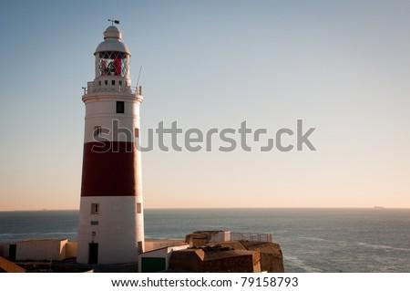 Morning sunrise at the lighthouse Europa Point Gibraltar - stock photo