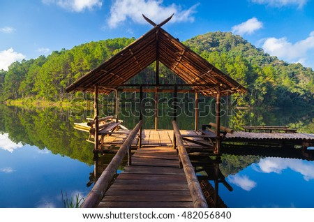 Morning sunrise, Bamboo bridge, gazebo and bamboo raft at Pang Oung, Mae Hong Son province, Thailand