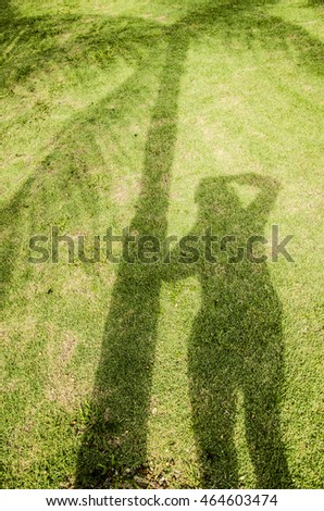 Morning sunrise is a good time for outdoor photography with the sun behind you throwing long shadow cast / Shadow background / Yours truly having her selfie shadow next to a palm tree