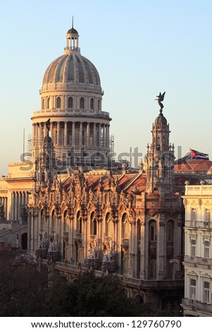 Morning Sunrise Reflecting Off The Gran Teatro de La Habana And The Capitolio Buildings With Central Park In The Shade - stock photo