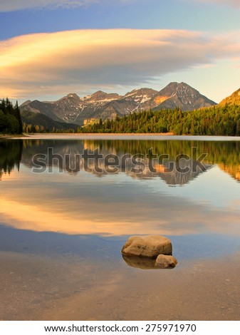 Morning sunrise reflection in the Utah mountains, USA. - stock photo