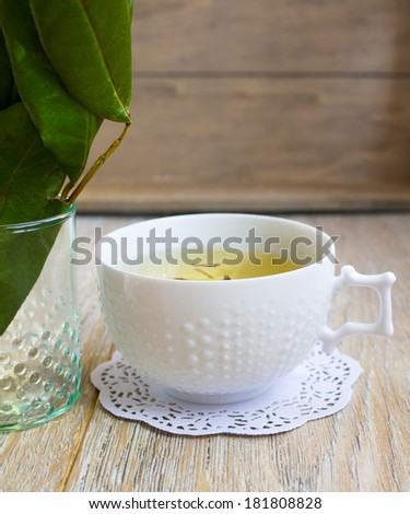 Morning tea, cup with green tea on the table - stock photo