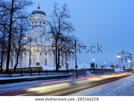 Morning traffic by Lutheran Cathedral in Helsinki - stock photo