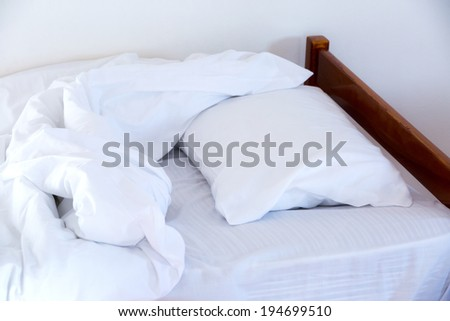 morning unmade bed close up - stock photo