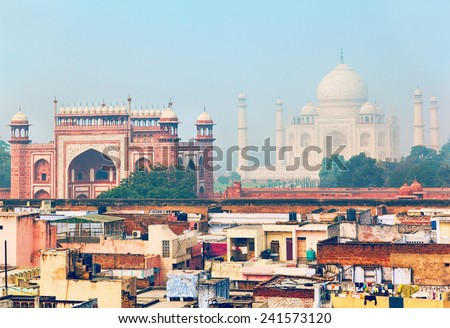 Morning view at residential quarter in Agra with Great gate (Darwaza-i rauza) and Taj Mahal as a backdrop - stock photo