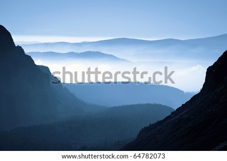 morning view from mountains to the foggy valley, autumn in High Tatras, Slovakia