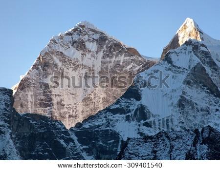 Morning view of Kangtega peak - way to Everest base camp, Khumbu valley, Nepalese Himalayas - stock photo