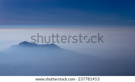 Morning view of the mountains above the clouds.