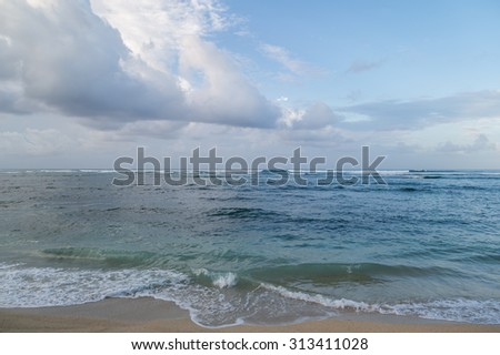Morning view of Waikiki Beach and surf  for use as an advertising backdrop or for use as wallpaper.