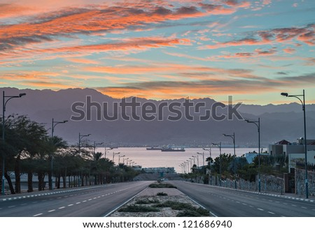 Morning view on a street running to the Red Sea in Eilat, Israel - stock photo