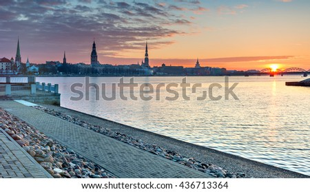Morning view on medieval city of Riga from embankment of the left bank of Daugava river. Riga is the capital of Latvia and famous Baltic city of medieval architecture - stock photo