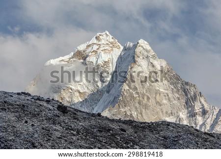 Morning view the peaks Kantega (6783 m) and Thamserku (6608 m) from Tengboche monastery - Nepal, Himalayas - stock photo