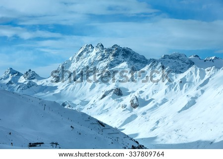 Morning winter Silvretta Alps landscape with ski run and ski lift (Tyrol, Austria).
