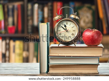 Morning with books and apple - stock photo