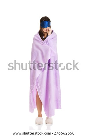 Morning woman wrapped in coverlet wearing eyes band. - stock photo