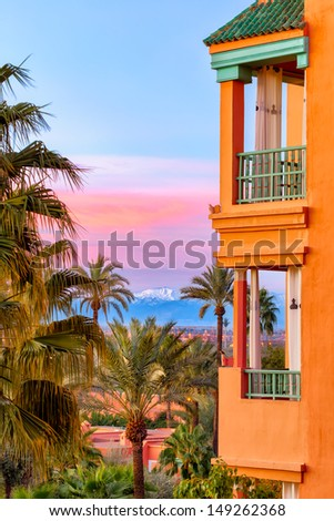 Moroccan architecture in typical colors against a beautiful sky in the morning sun  - stock photo