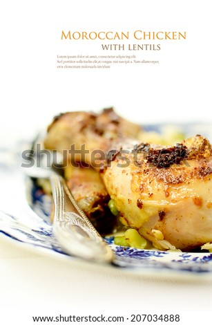 Moroccan Chicken with lentils against a light background. - stock photo