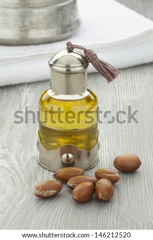Moroccan cosmetic Argan oil and nuts  - stock photo