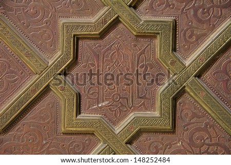 Moroccan embossed metal panel on a door in Fes, Morocco - stock photo