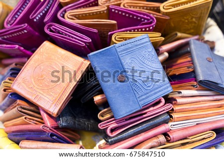 Moroccan handmade leather wallet, various colors. Horizontal Composition.