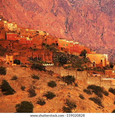 Moroccan kasbah in Atlas Mountains - stock photo