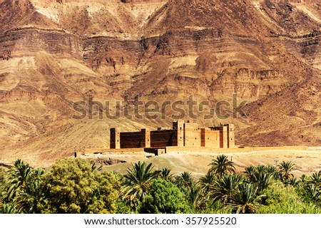 Moroccan kasbah in Draa Valley, Africa - stock photo