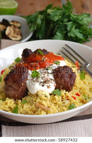 Moroccan lamb meatballs with couscous - stock photo