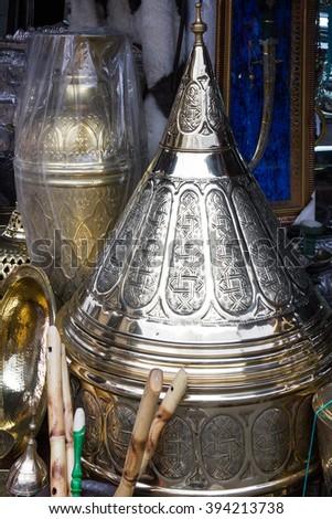 Moroccan souvenir and utensil market. Metal utensil stamping on market, Casablanca, Morocco - stock photo