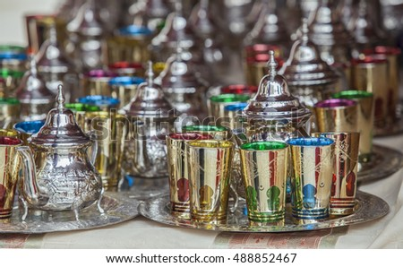 Moroccan tea sets. Glasses of colors, metal teapots and silver-plated trays