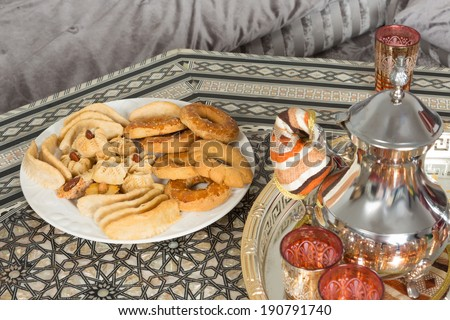 Moroccan tea tray and ramadan cookies ready for guests - stock photo