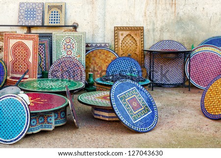 Moroccan tile mosaic table tops and fountains.  Location: Fez, Morocco - stock photo