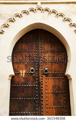 Moroccan traditional door in Fes El Bali - stock photo