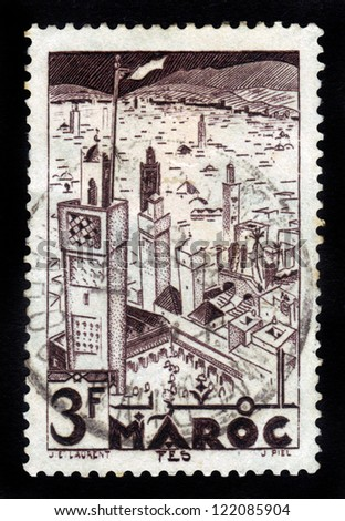 MOROCCO - CIRCA 1951: A stamp printed in French Morocco shows Mosques of  Fes, circa 1951 - stock photo