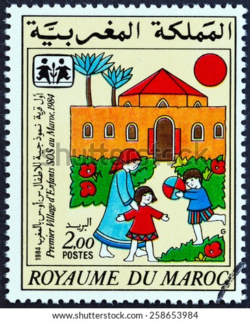 MOROCCO - CIRCA 1985: A stamp printed in Morocco issued for the 1st Moroccan S.O.S. Children's Village shows SOS Children Village, circa 1985.  - stock photo