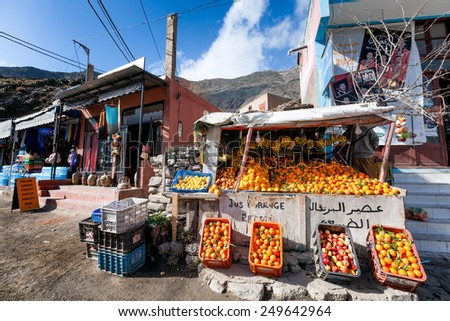 MOROCCO-DEC.25, 2012: Roadside fruit stand on the Tizi-n-Tichka Pass through the High Atlas Mountains, at about 7,400 feet elevation, the highest major mountain pass in North Africa.  - stock photo
