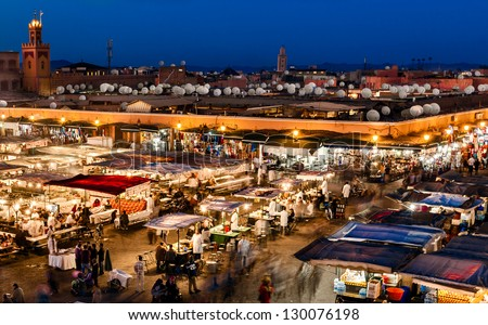 MOROCCO-DEC 24:The Night Market in the famous public square, a UNESCO site, in Marrakech, Morocco on Dec. 24, 2012. In the evening it fills with food stands, attracting crowds of locals and tourists. - stock photo